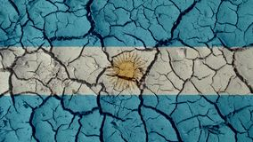 Political Crisis Or Environmental Concept Mud Cracks With Argentina Flag. Political Crisis Or Environmental Concept: Mud Cracks With Argentina Flag royalty free stock photo