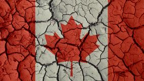 Mud Cracks With Canada Flag. Political Crisis Or Environmental Concept: Mud Cracks With Canada Flag stock photography