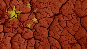 Mud Cracks With China Flag. Political Crisis Or Environmental Concept: Mud Cracks With China Flag stock photography