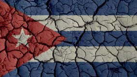 Mud Cracks With Cuba Flag. Political Crisis Or Environmental Concept: Mud Cracks With Cuba Flag stock images