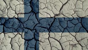 Political Crisis Or Environmental Concept Mud Cracks With Finland Flag royalty free stock image