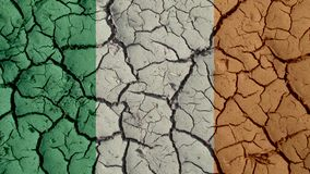 Political Crisis Or Environmental Concept Mud Cracks With Ireland Flag royalty free stock photography