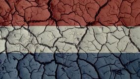 Political Crisis Or Environmental Concept Mud Cracks With Netherlands Flag. Political Crisis Or Environmental Concept: Mud Cracks With Netherlands Flag royalty free stock photography