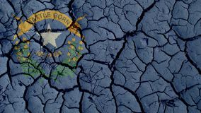 Political Crisis Concept: Mud Cracks With Nevada Flag royalty free stock photo