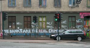 Political Graffiti. Protest graffiti directed at the banking sector in Oslo, Norway in May 2013 stock image