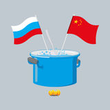 Political kitchen. Russia and China community. Cook soup in one Stock Photo