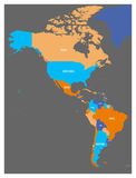 Political map of Americas in four colors on dark grey background. North and South America with country labels. Simple Stock Image