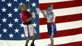 Political parties sparring against American Flag stock video