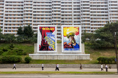 Political propaganda in North Korea. Huge propaganda posters on the streets of Pyongyang, North Korea. Such colorful political messages are shown all over the Royalty Free Stock Image