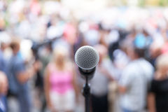 Political protest. Public demonstration. Microphone. Stock Images