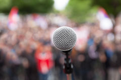 Political protest. Public demonstration. Microphone. Stock Image