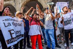 Political protests, Antigua, Guatemala. Antigua, Guatemala - September 15, 2017: Locals wave Guatemalan flags & slogans protesting against government corruption stock photo