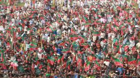 Political Rally Crowd Pakistan Tehreek-e-Insaaf. Sialkot, Pakistan - Mar 23: Massive crowd support for cricket turned politician Imran Khan during a political stock video footage