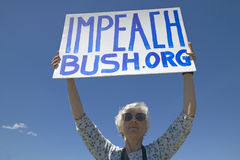 Political rally with a sign reading Impeach Bush Royalty Free Stock Photo