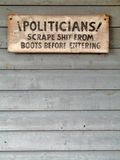 Political sign. Western polical sign painted on rustic wood Royalty Free Stock Photos