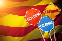 Political slogan FREEDOM in the form of traffic signs with Flag of Catalonia on the background Royalty Free Stock Photography