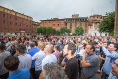 Political square speaking. Bologna, Italy - May 10, 2014: vast crowd listening famous politician Beppe Grillo speaking in Piazza San Francesco for Movimento 5