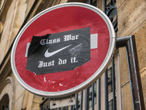 Political sticker on Paris street sign Stock Photo