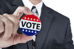 Political vote badge. A politican is promoting the right to vote in political elections in the USA royalty free stock photos