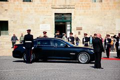 Politician arriving at the Auberge de Castile, Valletta. Political dignitaries arriving outside the Auberge de Castille office of the Prime Minister in Castille Royalty Free Stock Images