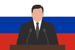 Politician behind podium, flag of Russia at background Stock Images
