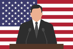 Politician behind podium, USA flag at background Stock Photo