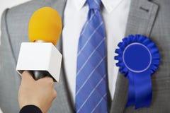 Politician Being Interviewed By Journalist During Election. Male Politician Being Interviewed By Journalist During Election Royalty Free Stock Images