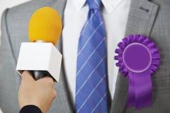 Politician Being Interviewed By Journalist During Election. Male Politician Being Interviewed By Journalist During Election Stock Photos