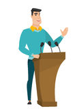 Politician giving a speech from tribune. Stock Photo