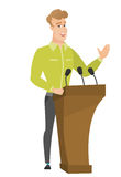 Politician giving a speech from tribune. Royalty Free Stock Image