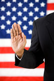 Politician: Hand Raised to Take an Oath Royalty Free Stock Photography