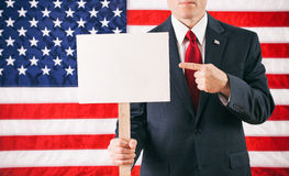 Politician: Holding A Blank Sign On A Stick And Pointing Royalty Free Stock Photo