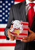 Politician: Holding a Christmas Present Stock Photos