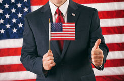 Politician: Holding Flag With A Big Thumbs Up For Success Royalty Free Stock Photo
