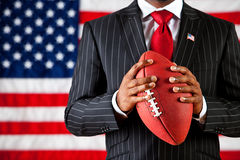 Politician: Holding a Football Royalty Free Stock Image