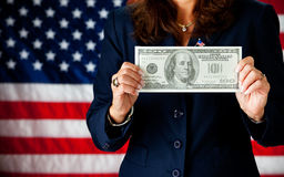 Politician: Holding a Large Hundred Dollar Bill royalty free stock photos