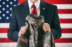 Politician: Holding A Military Uniform Jacket Royalty Free Stock Images
