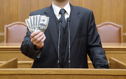 Politician holding money Stock Image