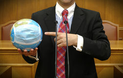 Politician holding the planet Earth stock images