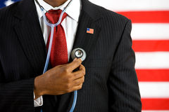 Politician: Holding a Stethoscope Medical Concept Royalty Free Stock Images