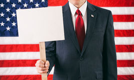 Politician: Holding Up A Blank Sign For Message Royalty Free Stock Photos