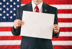 Politician: Holding Up A Blank Sign For Message Stock Photo
