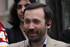The politician Ilya Ponomarev speaks at an oppositional action Stock Photos