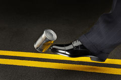 Politician kicking the can down the road Stock Photo
