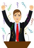 Politician man celebrating with fists up at podium. Portrait of happy young politician man celebrating with fists up at podium standing under falling confetti Royalty Free Stock Images