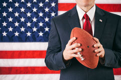 Politician: Man Holding American Football Stock Images