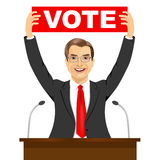 Politician man holding a banner with vote text message Stock Images