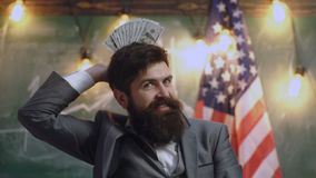 Politician: Man Holding Fanned Out US Currency. Progress in business usa flag background. Financial Stock Market Graphs. Business and finance, luck or fortune stock footage