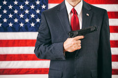 Politician: Man Holding Handgun Concept For 2nd Amendment Rights Stock Image