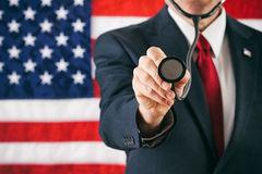 Politician: Man Holding Out Medical Stethoscope stock images
